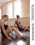 Small photo of Young ballerinas exercises. Teenage sport. Pensive ladies in dance class, pretty girls stretching. Sensibility from childhood. Gym background, healthy teen lifestyle, femininity concept
