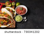three mexican tacos with... | Shutterstock . vector #730341202