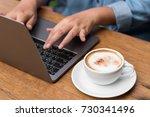 hands typing on laptop in... | Shutterstock . vector #730341496