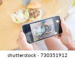 hand hold phone take brunch... | Shutterstock . vector #730351912