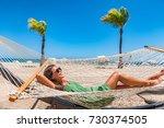 beach relaxation sun tanning...   Shutterstock . vector #730374505