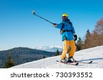 shot of a professional skier... | Shutterstock . vector #730393552