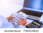 businessman with money in hand  ... | Shutterstock . vector #730414822