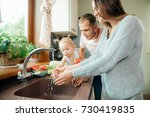 young beautiful parents and her ... | Shutterstock . vector #730419835