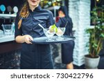 waiters carrying plates with... | Shutterstock . vector #730422796