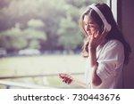 asian girl student watching... | Shutterstock . vector #730443676