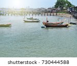 fishing boats in the harbour...   Shutterstock . vector #730444588