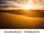 Small photo of Beautiful sunset in the Sahara desert. Sand dunes at sunset