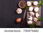 fresh champignon mushrooms with ...   Shutterstock . vector #730473682