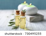 bottles with rosemary oil and...   Shutterstock . vector #730495255