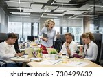 angry boss yelling at her co... | Shutterstock . vector #730499632