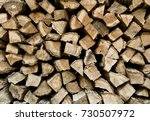 stacked firewood background | Shutterstock . vector #730507972