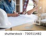 architect working on blueprint  ... | Shutterstock . vector #730511482