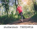man in red t shirt runner... | Shutterstock . vector #730524916