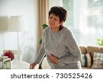 mature woman suffering from... | Shutterstock . vector #730525426
