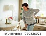 mature woman suffering from... | Shutterstock . vector #730526026