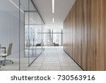 upscale office corridor with... | Shutterstock . vector #730563916