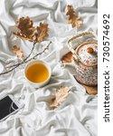 cup of green tea  headphones ... | Shutterstock . vector #730574692