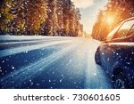 car on winter road in the... | Shutterstock . vector #730601605