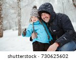 dad and son having fun in... | Shutterstock . vector #730625602