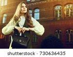 outdoor waist up portrait of... | Shutterstock . vector #730636435