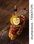 tapas on crusty bread  ...   Shutterstock . vector #730657195