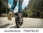 woman on her  kick scooter on... | Shutterstock . vector #730678132