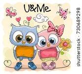 two cute cartoon owls on orange ...   Shutterstock . vector #730689298