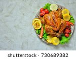 fried chicken whole on a plate... | Shutterstock . vector #730689382