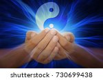 hands with yin yang | Shutterstock . vector #730699438