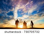 three disabled people looking... | Shutterstock . vector #730705732