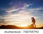 man standing on rocks  looking... | Shutterstock . vector #730705792