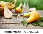 fresh pears and shot glass with ... | Shutterstock . vector #730707868