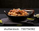 delicious chicken biriyani | Shutterstock . vector #730756582