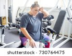 fat girl in a gym | Shutterstock . vector #730764475