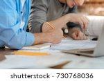 two male colleagues creating a... | Shutterstock . vector #730768036