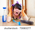 housewife washes a floor in the house - stock photo