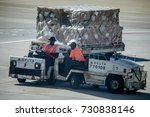 Small photo of Atlanta, Georgia, USA - October 13, 2016: Dolly fleet operators with the dollies for baggage unit load devices at busy Hartsfield-Jackson Airport.