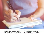 close up hand woman are writing ...   Shutterstock . vector #730847932