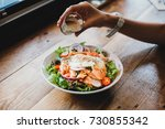right hand pours cream dressing ...   Shutterstock . vector #730855342