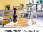table and chairs at a sidewalk...   Shutterstock . vector #730863112
