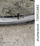 Small photo of flat tire , bicycle flat tire on road
