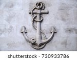 a stone carving of an anchor... | Shutterstock . vector #730933786