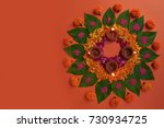 diwali flower rangoli with leaf ... | Shutterstock . vector #730934725