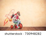 child playing with jet pack.... | Shutterstock . vector #730948282