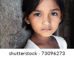 Stock photo portrait of a pretty year old filipina girl in poverty stricken neighborhood natural light 73096273
