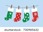 set with christmas socks ... | Shutterstock .eps vector #730985632
