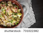 bowl with quinoa salad on table