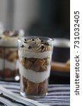 tiramisu layered in a glass | Shutterstock . vector #731032405