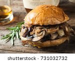 burger with mushrooms  fried... | Shutterstock . vector #731032732